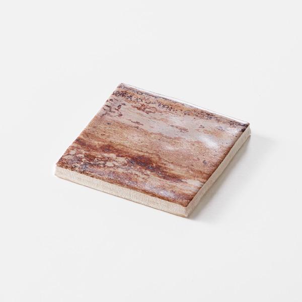褐色の石目調のプリントタイルです。壁タイルとしてご利用頂けます。