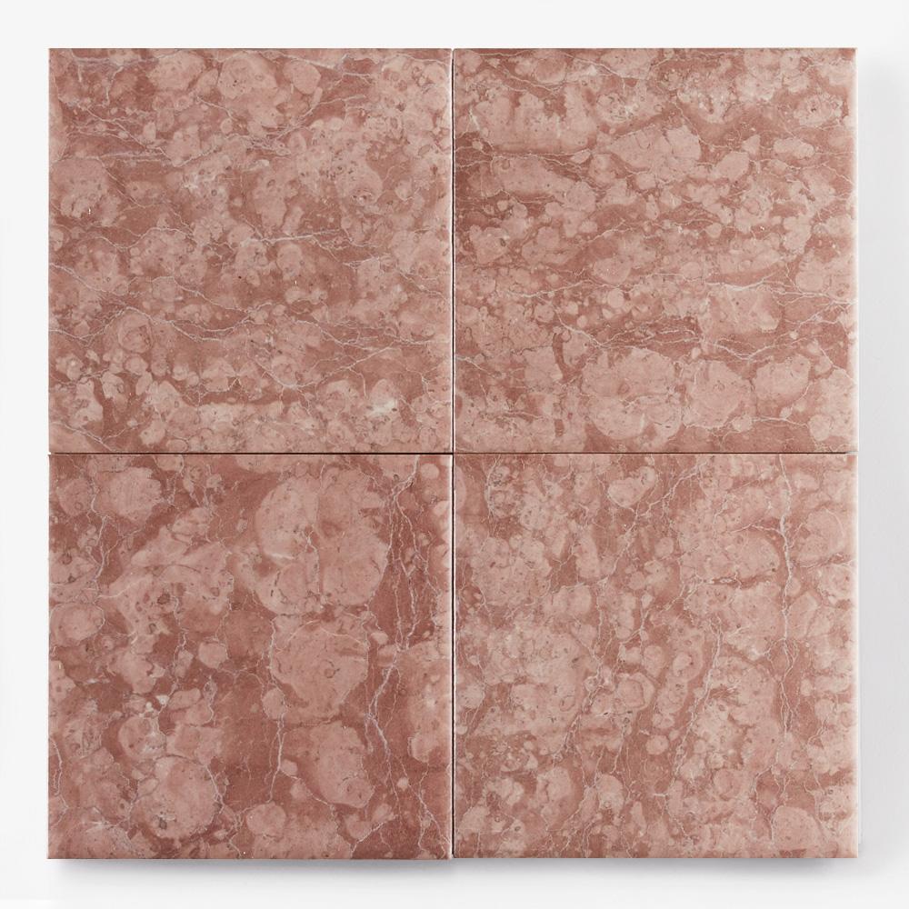 赤色の石目調のプリントタイルです。壁タイルとしてご利用頂けます。8パターンの石目の組み合わせとなります。