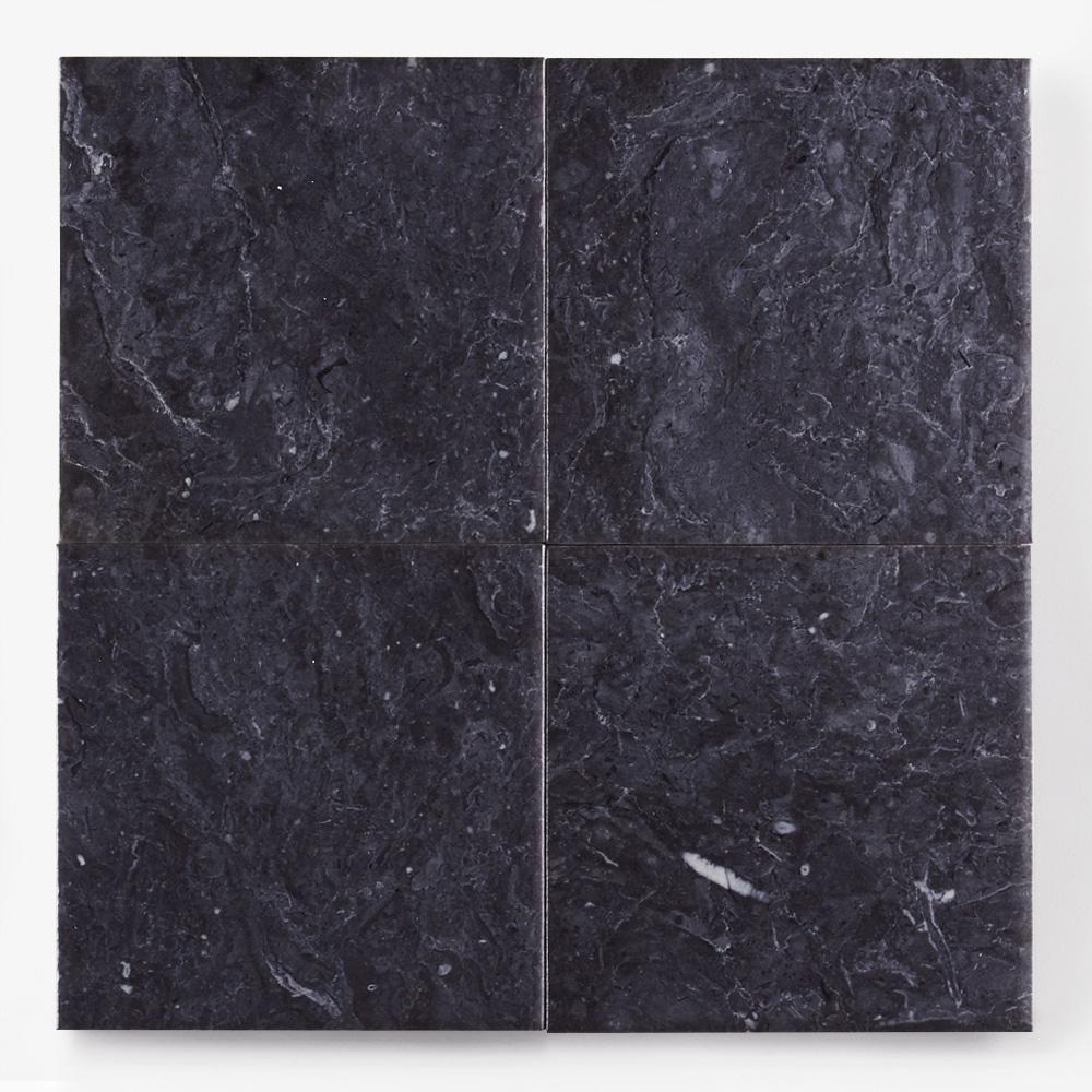 黒色の石目調のプリントタイルです。壁タイルとしてご利用頂けます。8パターンの石目の組み合わせとなります。